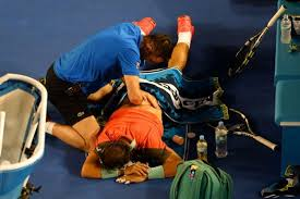 Rafa getting treatment in the final of the Aus Open 2014