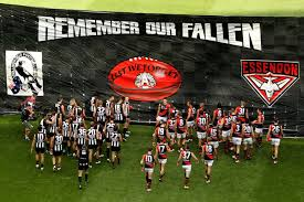 Collingwood and Essendon running through the banner. www.abc.net.au